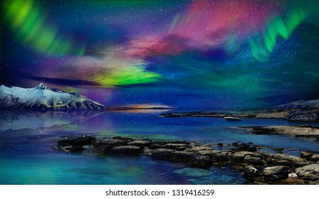 Beautiful northern lights of the northern part of the planet. Magnificent views of the ocean and northern lights with rocks and stones. Beautiful sea water plays with colors and light