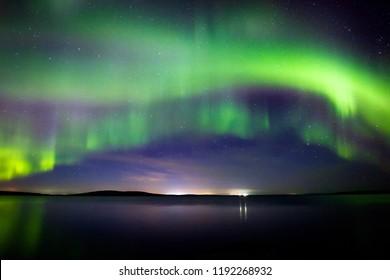Beautiful  Northern Lights (polar lights, aurora borealis) in September (unique phenomenon) on the starry sky