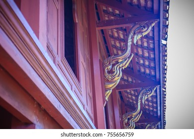 Beautiful northern thai style house pattern of teak wood craving on balcony baluster. Antique balcony banister with retro style.