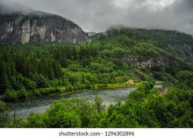 Beautiful Norway forest landscape and scenery view of hills, mountain and river in a cloudy day