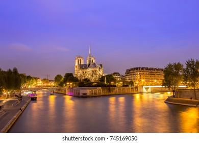 The beautiful Notre Dame de Paris and Seine River at blue hour