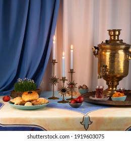 Beautiful Novruz table set up in blue with semeni, wheat grass, sweets and dry fruits and festive candles with tea and golden samovar. Traditional celebration of spring equinox in March in Azerbaijan