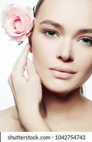 Beautiful Nude Make-up Woman with Flower. Beauty Portrait of girl with Rose Flower. Clean Face, care