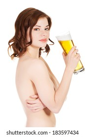 Beautiful nude woman is holding glass with beer.