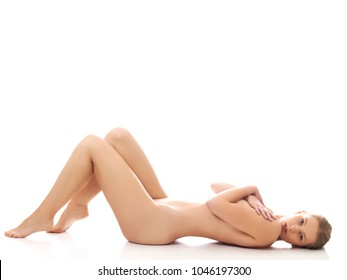 Beautiful nude woman lieing on flor. Spa concept