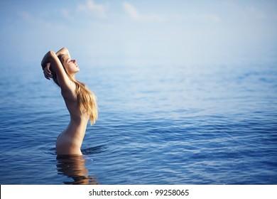 Beautiful nude woman on beach, bali