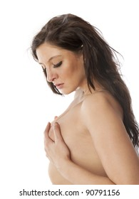 Beautiful nude woman self examining her breasts for lumps on white background