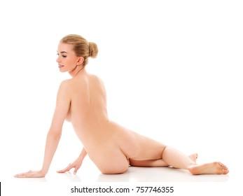 Beautiful nude woman sitting on flor