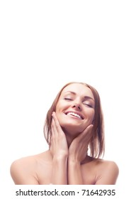 beautiful nude young woman touching her neck and smiling, a lot of copy space above her