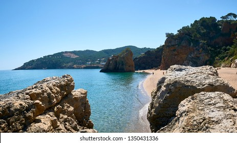 Beautiful nudist beach of Platja de Pals, Costa Brava, Girona - Spain. Rocky rough coastline. Mountain vegetation beautiful summer day. Common tourism destination for French, Dutch, German, English.