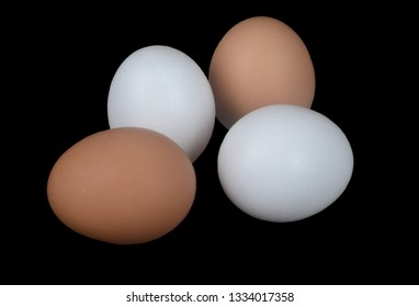 Beautiful Nutritional Brown and White Eggs On Black