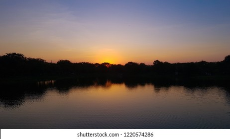 Beautiful nutural sunset over forest or lagoon. Countryside landscape in Thailand