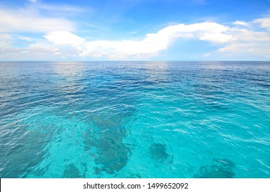 a beautiful ocean against blue cloudy sky in southern of Thailand.