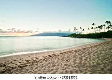 Beautiful ocean beach along west Maui's famous Kaanapali beach. Long exposure at sunset