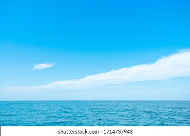 Beautiful Ocean and blue sky wih white cloud background.