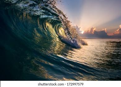 Beautiful ocean surfing shorebreak wave at sunset time