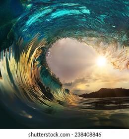 Beautiful ocean surfing wave breaking at sunset beach