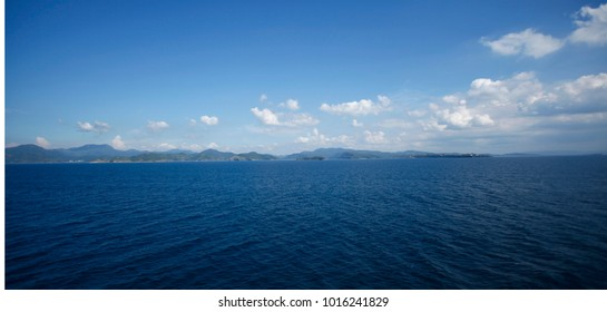 beautiful ocean view with blue water and blue sky with white cluds
