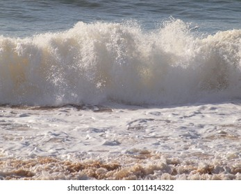 Beautiful ocean waves at a beach of the Algarve coast in Portugal