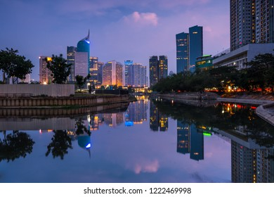 Beautiful office buildings reflected in the water in the dusk in Jakarta, Indonesia.