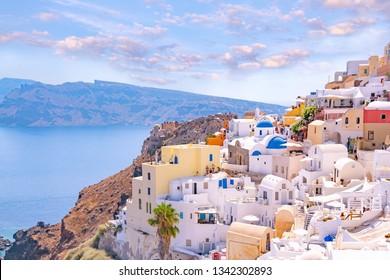 Beautiful Oia town on Santorini island, Greece. Traditional white houses over the Caldera, Aegean sea. Scenic travel background.