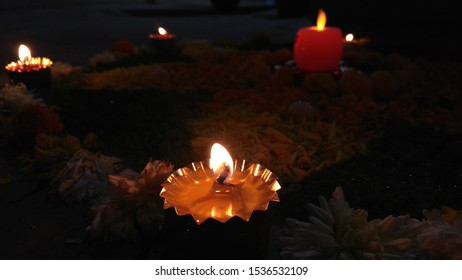 Beautiful oil lamp kept on a flower rangoli is burning peacefully and radiating its light during the festival of Diwali in India.