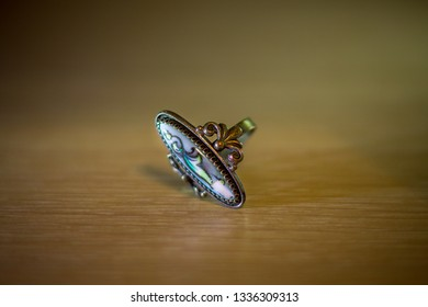beautiful old ancient vintage retro style ring lies on a wooden surface, antique jewelry is very fashionable now
