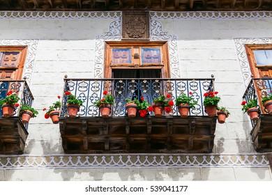 beautiful old balcony wth flower pots in La Orotava, Tenerife, Spain