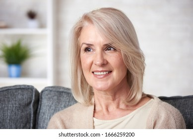 Beautiful old blonde woman is smiling at home
