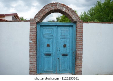 Beautiful old blue color wooden door in a stone wall, background seem tree at Camlibel village, Balikesir, Turkey