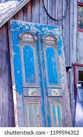beautiful old blue door at a salvage yard