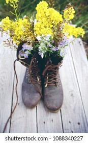 Beautiful old boots filled with flowers