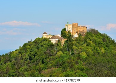 Beautiful old castle Buchlov. South Moravia-Czech Republic-Europe. Spring landscape with forests, castle and blue sky.