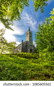 Beautiful old christian church in the green wood