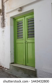 beautiful old green door in a white wall