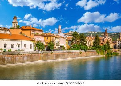 Beautiful old houses on  Adige river in Verona, Veneto region, Italy.