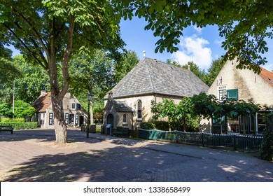 Beautiful old houses on a small square in the place Nes on the island Ameland