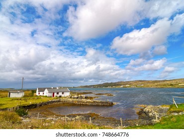 beautiful old irish cottage by the sea. cottage set in a scenic rural irish countryside.