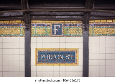 Beautiful old mosaic sign and ornaments in Fulton Street Subway Station, New York City, USA
