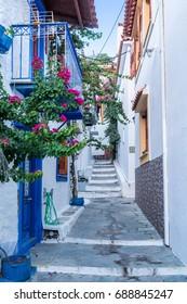 Beautiful old, narrow alley in Skiathos, Greece