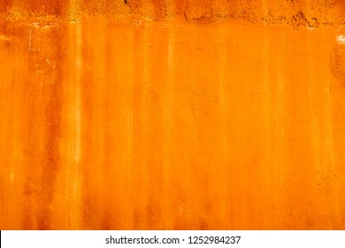 Beautiful old red brown orange rust plaster Moroccan tadelakt wallpaper background texture.