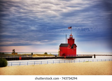 Beautiful old red lighthouse on the beach of Michigan lake in Holland