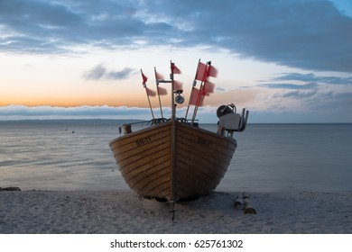 Beautiful old sail ship on the beach. It is a kind of landmark at the Baltic Sea in Binz on Ruegen island, Germany. Image taken as a long shutter at sunset.