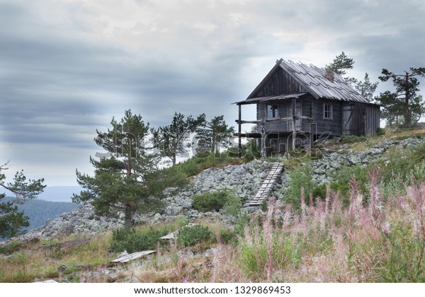 Beautiful old Santa Claus cottage on the top of Levitunturi fell on autumn. This cabin is near of hiking trails and it is very popular place for tourist to take photos in all seasons