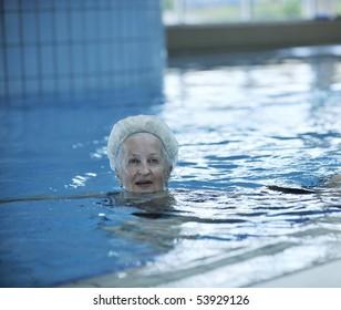 beautiful old senior  woman have fun and recreation on swimming pool