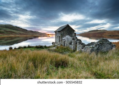 A beautiful old stone boathouse on the shores of Devoke Water on the Lake District National Park in Cumbria