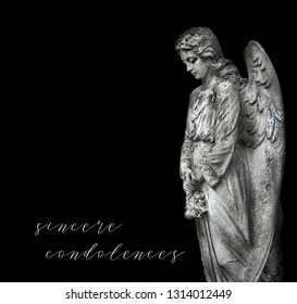 "beautiful old stone statue of sad angel. stone memorial grieving angel statue on black background. condolence, mourning cards or obituary. inscription ""sincere condolences""."
