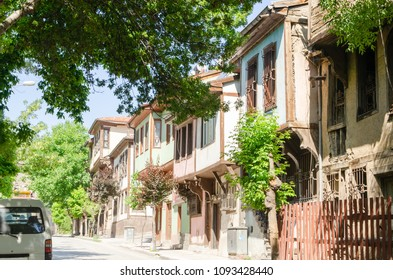 Beautiful old street in downtown with houses with wooden shutters in the classic Turkish Ottoman style, Turkey, center of Afyonkarahisar The two-storyed buildings