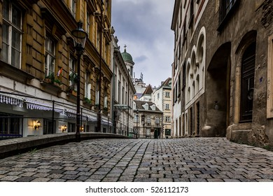 beautiful old street paved with stones and old buildings on a rainy day in Vienna/Europe