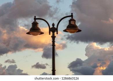 Beautiful old streetlight against the background of the sky